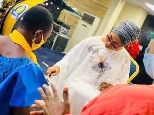 f25fcb3513d4c6351bdd140e9831bb1d 300x225 - Richest Woman In Nigeria,Folorunso Alakija Caught Anointing Her Church Members