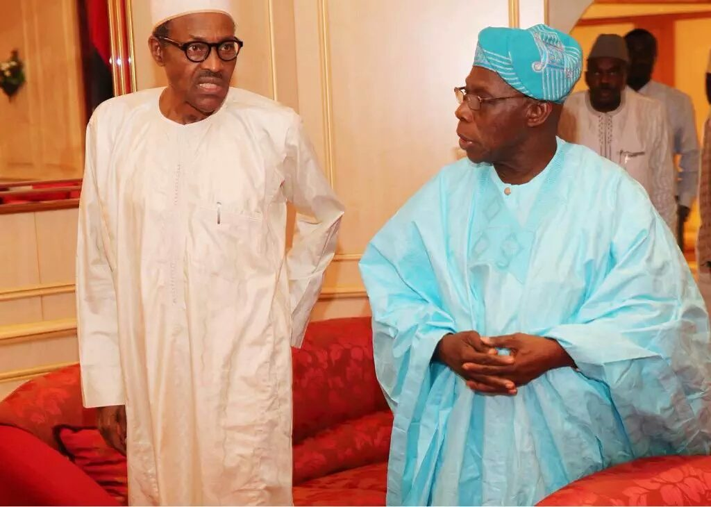 Buhari and Obasanjo after a close-door meeting at the state house in Abuja