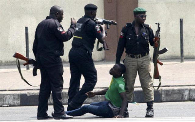 Nigerian Police dragging an offender