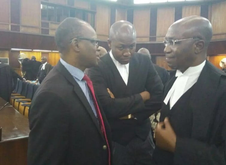 Factional PDP candidate Eyitayo Jegede in supreme courtroom with Dr. Bode Olanipekun SAN and his father, Chief Wole Olanipekun SAN on Tuesday, November 22