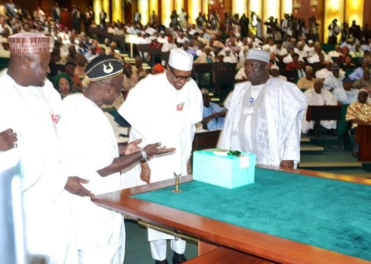 President Buhari presenting the N7.298trn 2017 budget as his national assembly aides watch.