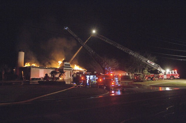 Firefighters battle to stop the fire in the early hours of Saturday, January 28.
