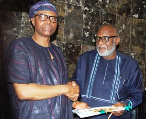 Mimiko hands over to Akeredolu 300x246 - Politically Dead Mimiko Needs Agboola's Money – Akeredolu