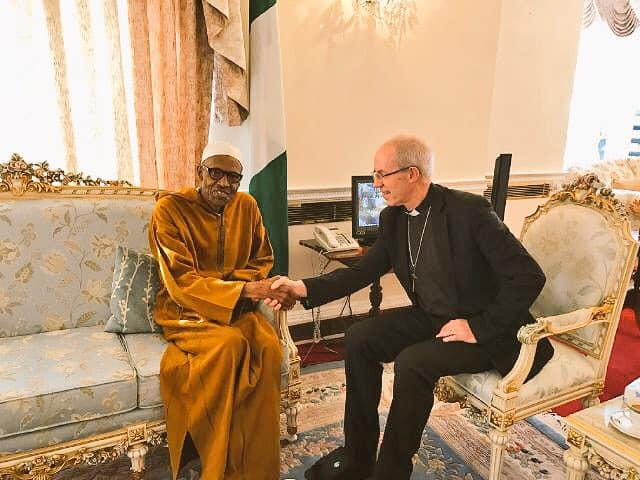 Buhari exchanging pleasantries with