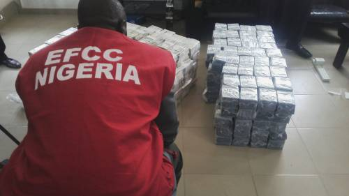 EFCC operative with money confiscated at Kaduna Airport