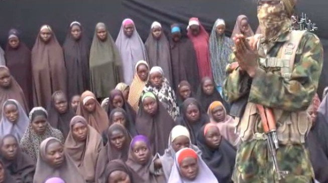 A Boko Haram commander with the group of girls
