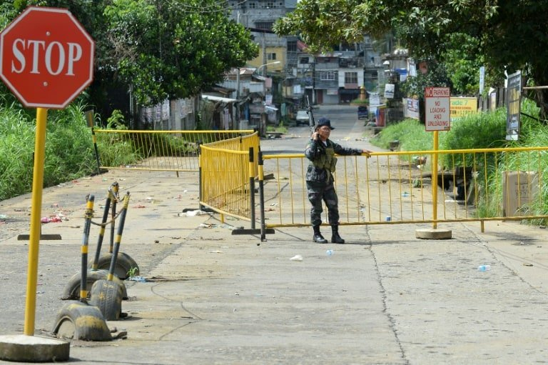 Philippines pounds militants; civilians found shot dead