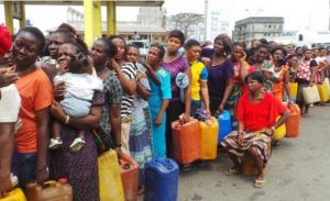 Nigerians in a tight queue to buy kerosene at NNPC station e1484468765532 1 300x183 - IPMAN Has Directed Petrol Stations To Start Selling Fuel At A Price Of N170