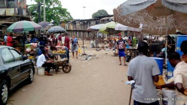 People buying and selling at Emejulue /Ajasa market, Onitsha