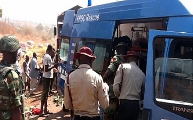 FRSC officials at the accident scene of the Lagos Ibadan highway - Scores Feared Dead, Injured In Adamawa Road Crashes