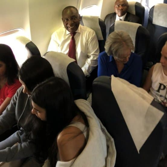 Ramaphosa-first-left-on-second-row-sitting-in-the-Economy-Class-of-Safair