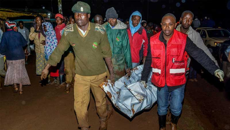 Emergency responders evacuating victim's bodies after Patel dam burst its bank in Solai Nakuru County Kenya