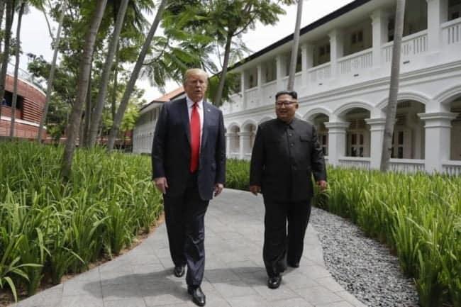 Trump-and-Kim-walk-together-e1528780622128