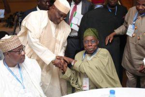 Atiku goes for his Oga Obasanjos handshake e1530120681746 300x200 - Buhari Is Still Trying To Correct The Problems Obasanjo, Atiku Brought On Nigeria – APC