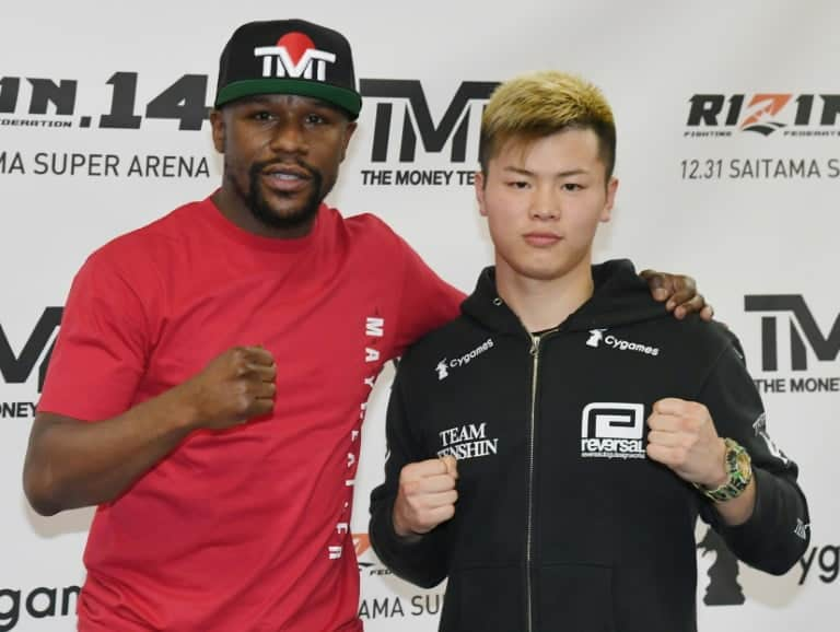 American Floyd Mayweather Jr. and Japanese kickboxing champion Tenshin Nasukawa pose before press conference on December 6, 2018 in Las Vegas