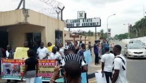 Ambode Protest 1 300x170 - We Stand With Ambode – Group Protests At Lagos State House Of Assembly