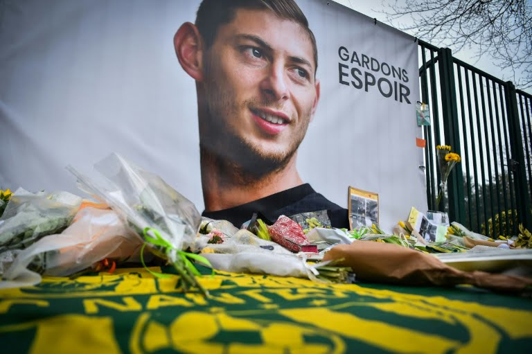 Flowers are placed at the foot of a portrait of Emiliano Sala to pay tribute to the footballer, in front of a training center in La Jonelière, January 25, 2019