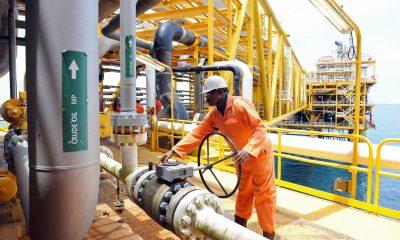 A worker inspect facilities on an upstre