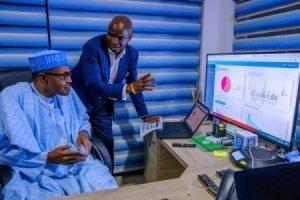 Buhari Fashola 2 300x200 - Buhari Spies At Election Results, Visits Situation Room (Photos)