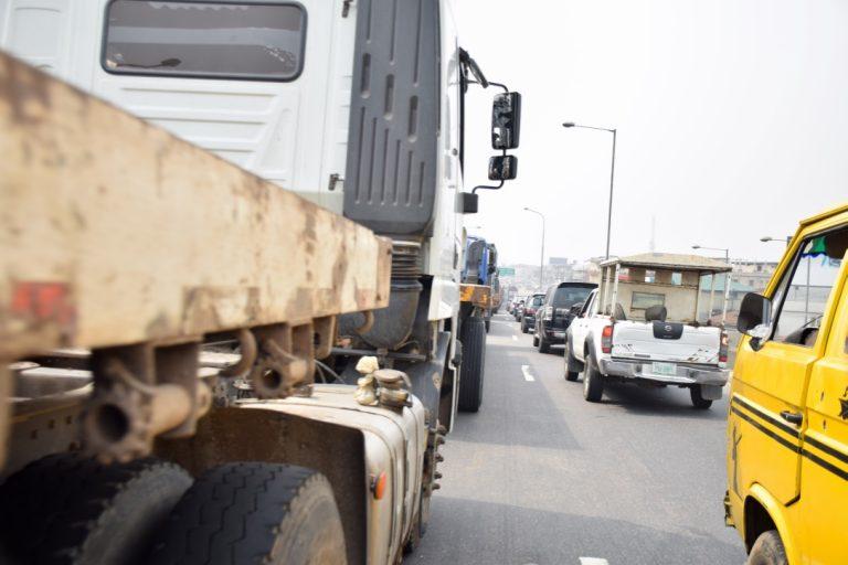 Trucks on Lagos bridge returns2 768x512 - Photos: Trucks Return To Lagos Bridge Shortly After Buhari's Departure