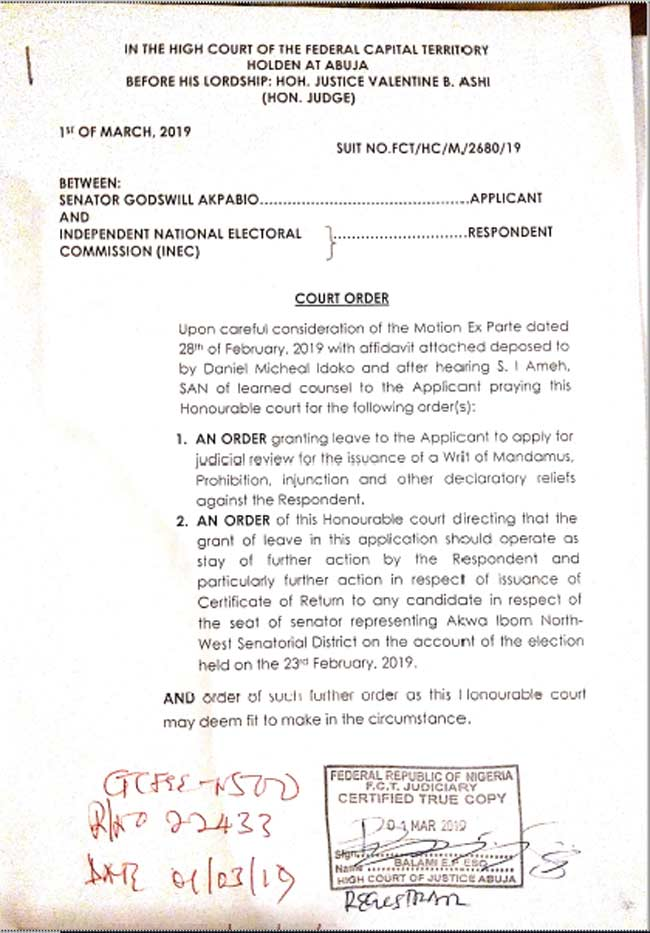 Court Paper1 - Court Stops INEC From Giving Certificate Of Return To Akpabio's Opponent