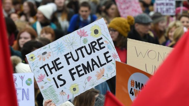 Poster in London saying The future is feminine women from all over the world hold marches and equal rights protests in the week of March 8 - International Women's Day: The Labor Origins of March 8