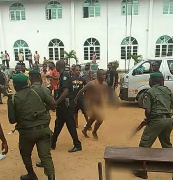 abia election mad man - Drama As Madman Disrupts Election In Umuahia, Abia State (Picture)