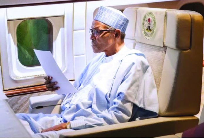 Buhari 1 696x471 - Revealed! Buhari Takes List Of Ministerial Candidates Abroad