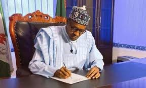 Nigerians React As Buhari Signs New Minimum Wage Bill Into Law