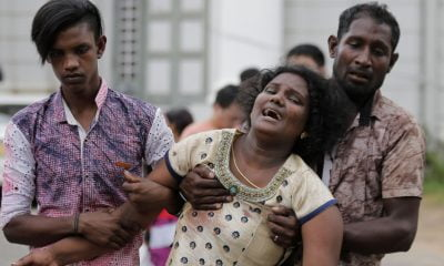 Relatives of a blast victim grieve outside a morgue in Colombo, Sri Lanka