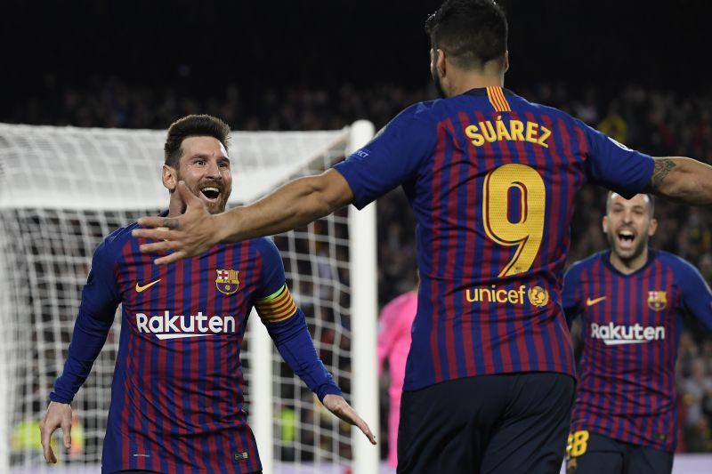 Messi celebrates with Suarez