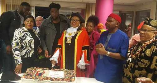 Obaze cutting her inauguration cake - Nigerian, Victoria Obaze Becomes Mayor In UK (Pictures)