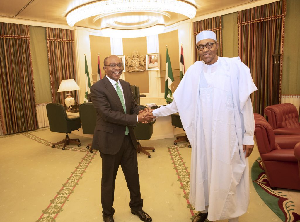 PRESIDENT BUHARI CONGRATULATES THE CBN GOVERNOR EMEFIELE 1B 1024x757 - Photo: The Moment Buhari Congratulated Emefiele On His Re-appointment