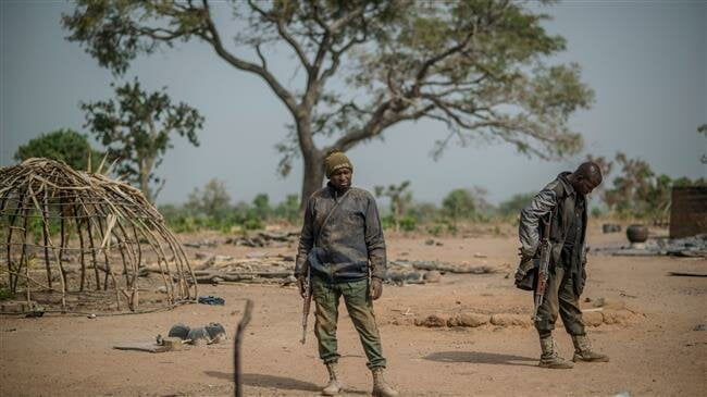 Two policemen stand guard at Unguwar Busa in Kaduna, Nigeria, on February 22, 2019. (Photo by AFP)