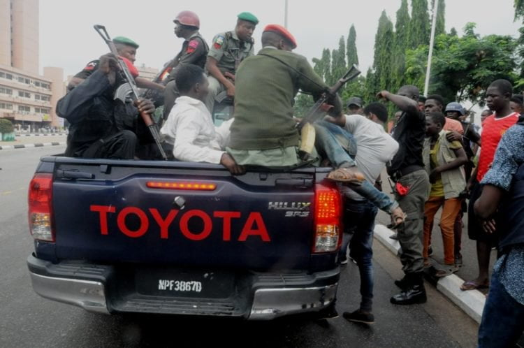 SHITTE 750x498 - Pictures: Police Arrest Shi'ite Members After Protest And Clash In Lagos