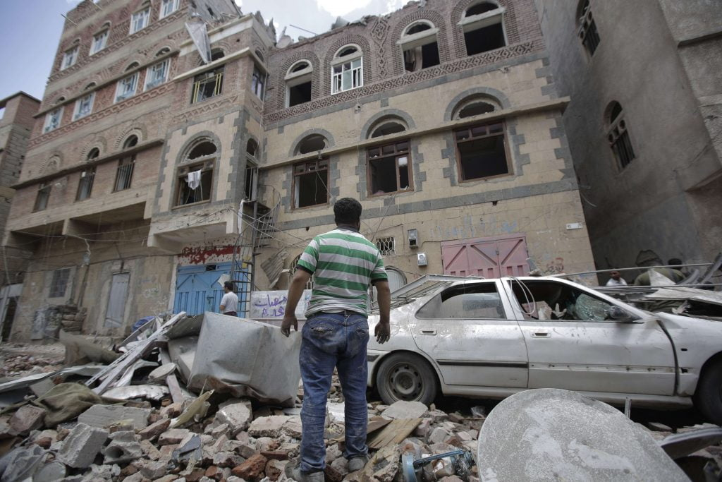 A man observes the damage caused by a coalition bombing on the Yemeni capital, Sanaa, on May 16, 2019. © Hani Mohammed / AP / SIPA