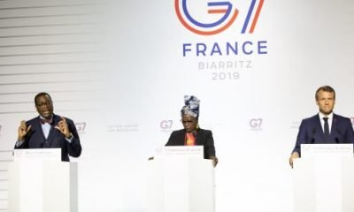 Akinwumi Adesina (AfDB President), Beninese artist Angélique Kidjo and French President Emmanuel Macron at a G7 press conference in Biarritz, August 25, 2019.