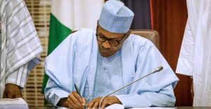 Buhari Signs 780x405 300x156 - Andimi's Killing: PFN Advise Buhari To Redeploy Security Chiefs