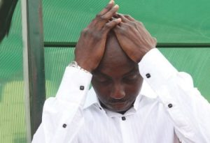 Samson Siasia sad 300x205 - Samson Siasia Begs Nigerians To Help Raise 90 million Naira