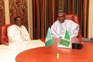 Bishop Kukah and Buhari 2 300x200 - 'Buhari Sacrificing Nigerians Dream For Northern Interest' – Kukah