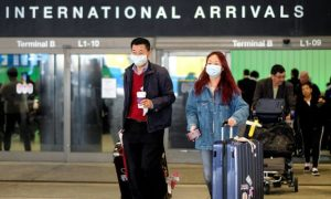 Passengers leave LAX after arriving from Shanghai China after a positive case of the coronavirus was announced in the Orange county suburb of Los Angeles Sunday. 300x180 - COVID-19: China Bars Nigerian Citizens From Entry