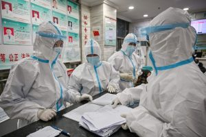 Staff at the Wuhan Red Cross Hospital wear coveralls to protect themselves from the coronavirus. 300x200 - First Case Of Chinese Coronavirus Reportedly Recorded In Ghana