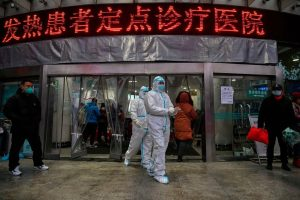 Workers in protective suits leave the Wahu Red Cross hospital. 300x200 - Virus In China: Death Toll Rises To 80, Foreigners Await Evacuation