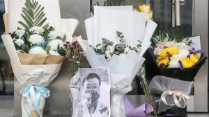 Bouquets of flowers in tribute to Li Wenliang in front of the Wuhan Central Hospital February 7 2020. 300x169 - Coronavirus: Death Of Doctor Li Wenliang Raises Outrage In China