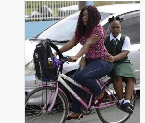 Mother on Bicycle 300x254 - Okada Ban: Mother Takes Her Daughter To School On Bicycle