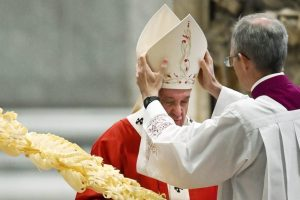 The priest Guido Marini places the miter on the head of Pope Francis on the occasion of the Palm Mass celebrated Sunday at the Vatican. 300x200 - Pope Francis Receives COVID-19 Vaccine