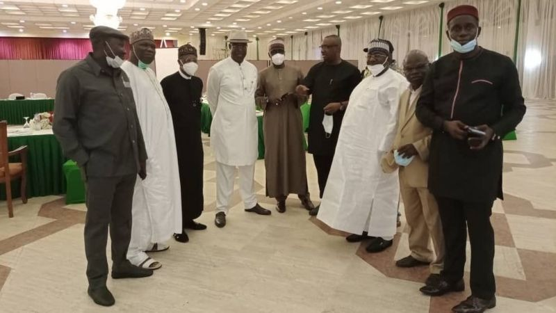 Nigerian labour leaders and government delegation after they reached an agreement early morning on Monday.