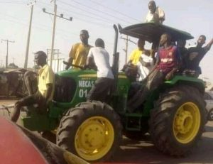 Looters in Adamawa 300x231 - Video: Moment Adamawa Looters Roll Away Tractor From Warehouse