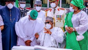 President Buhari seems to be making an important statement to his deputy Professor Yemi Osinbajo. 300x169 - FG List Individuals To First Get COVID-19 Vaccines In Nigeria