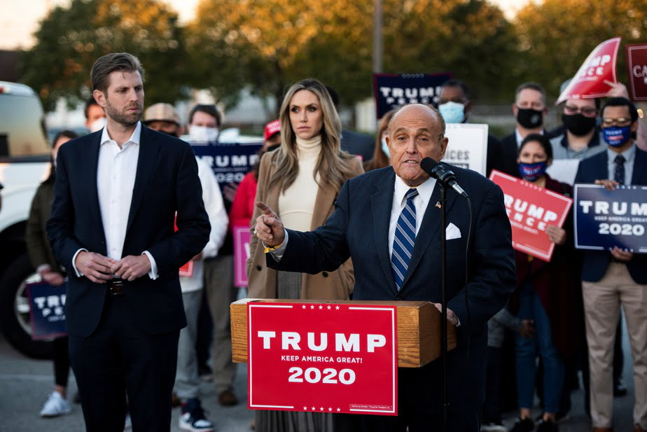 Donald Trumps personal lawyer former New York Mayor Rudolph Giuliani was in Philadelphia with Eric Trump one of the presidents sons. - US Election: Biden Leads Trump With A Very Wide Margin